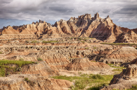 characteristic: A view of some of the rugged landscape and steep hills  characteristic of the terrain in the Badlands National Park in South Dakota.