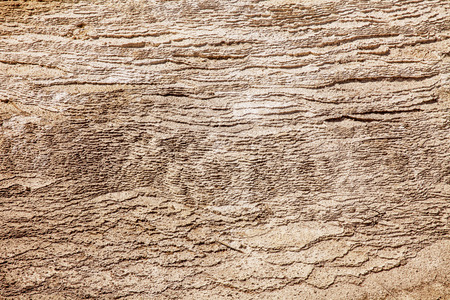 calcium carbonate: A natural texture background of hundreds of layers of calcium carbonate formed over years from one of the mineral springs at Mammoth Hot Springs in Yellowstone National Park.