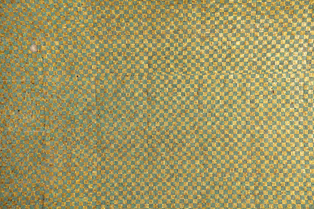 temple mount: A repeating pattern of green and gold tiles that lie on a ceiling overhead an entrance to the Dome Of The Rock shrine on the Temple Mount in the Old City of Jerusalem. Stock Photo