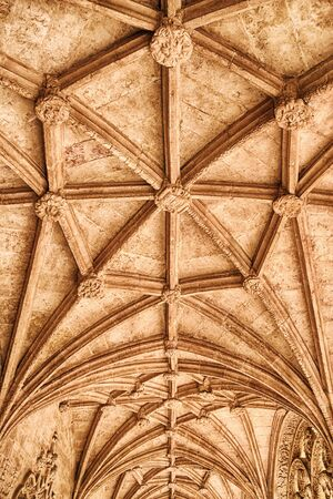 ribbed: A symmetrical pattern of stone beams forms the vaulted ceiling of a hallway in the Jeronimos Monastery in the Belem distrcit of Lisbon, Portugal.