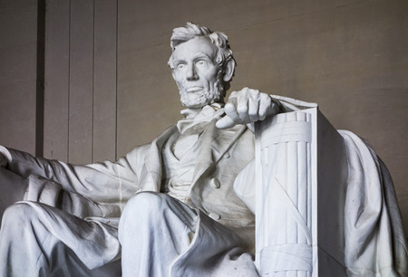 A statue of Abraham Lincoln sits in the Lincoln Memorial on the National Mall in Washington DC.