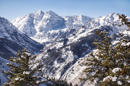 color: A view of the Maroon Valley landscape looking towards the two mountains of the Maroon Bells in Pitkin Country.