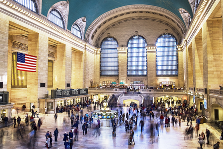 to depart: NEW YORK, UNITED STATES - NOVEMBER 1, 2015: The floor of the main hall in Grand Central Station in New York City with passengers and tourists moving around as trains arrive and depart.