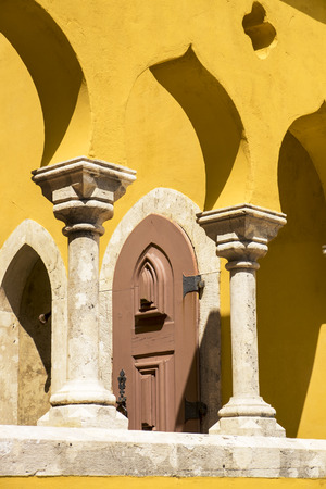 architectural  detail: A small architectural detail of the Pena Palace in Sintra, Portugal shows some of the distinctive features of arches and columns.