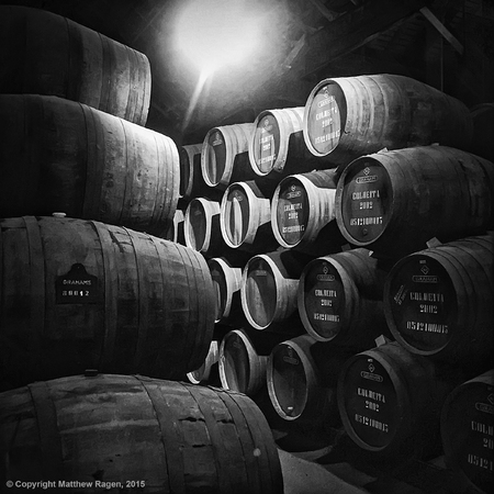 storage facility: PORTO, PORTUGAL - MAY 2, 2015: Barrels, or pipes, of vintage port wine are stacked up in a cellar at Grahams storage facility in the city of Porto in Portugal.