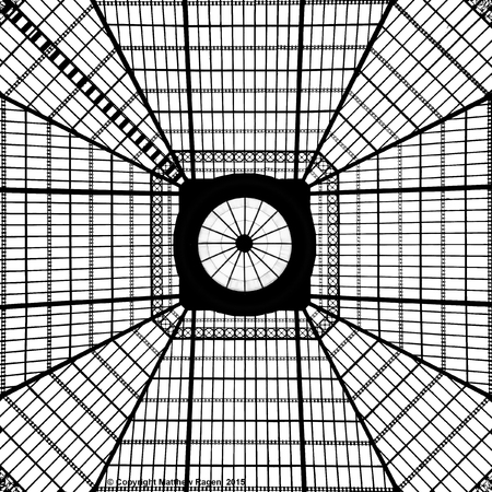 creates: A glass skylight overhead creates a black and white pattern.