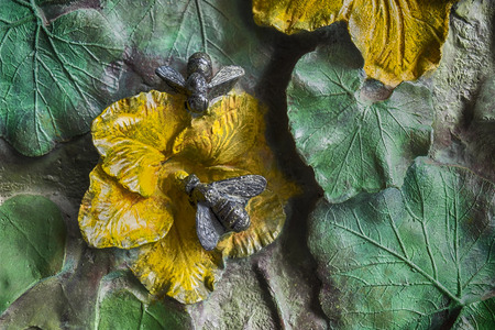 no entrance: A small detail of the external part of the doors of the Sagrada Familia cathedral in Barcelona shows two bronze bees, flowers, and leaves. Stock Photo