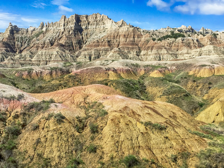 extreme terrain: Looking up from the main road through Badlands National Park in South Dakota, the extreme terrain of the mountain peaks appear to be incredibly rugged. Stock Photo