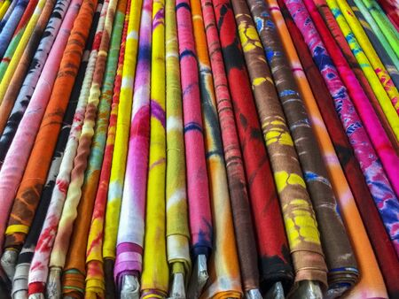 destined: Bolts of colorful cloth destined for clothing are organized in a store in the Mangaldas Market in central Mumbai.