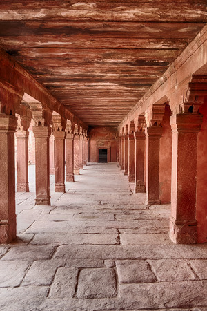mughal empire: A corridor constructed with red sandstone leads to the entrance to the Emperors bed chambers in the ancient city of Fatehpur, India