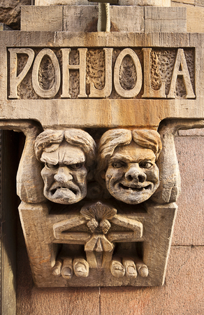 translated: Two stone trolls embedded in a building decoration in Helsinki holding up a structural element. Pohjola is a location in Finnish mythology, sometimes translated in English as Northland . It is one of the two main polarities in the Finnish national epic, t