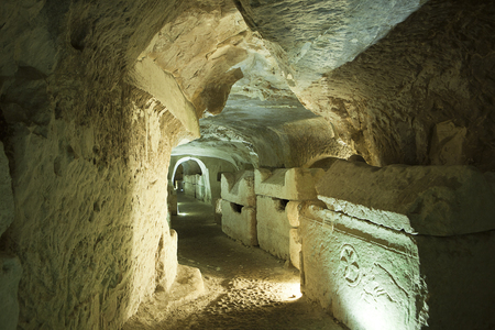 shearim: A series of large stone coffins or sarcophagi line the walls of an extensive series of tunnels carved into the soft chalk or limestone of the burial area near Bet Shearim in Israel.