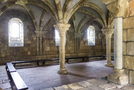 An old room at The Cloisters showcases an old Gothic architectural space with pillars and vaulted ceilings, New York City, United States.