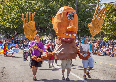 SEATTLE, WA - JUNE 22, 2013: Two men operate a huge puppet with one eye through the streets of the Fremont neighborhood during the annual Summer Solstice Parade in Seattle. Editorial