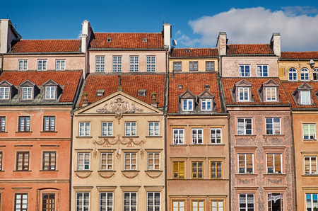 A section of the buildings that surround the main square of the Stare Mesto, or Old Town, of Warsaw, Poland. These were all rebuilt after World War II. Stock Photo
