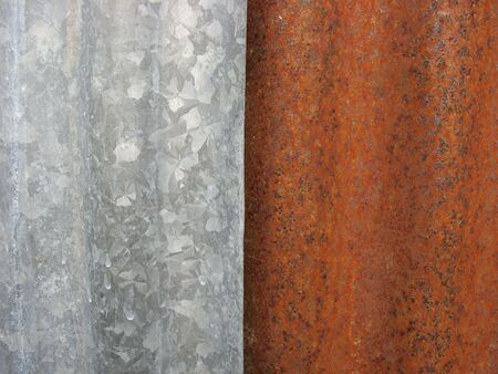 galvanize: rusted corrugated iron fence abstract
