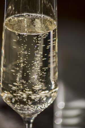 Close up portrait of golden champagne with bubbles in flute glass Banco de Imagens - 74581740