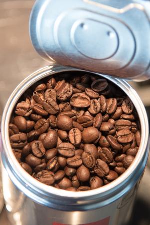 Open can of coffee beans Фото со стока
