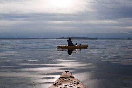 Evening Kayak on placid water Stock Photo
