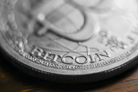 minted: Macro view of a minted silver bitcoin Stock Photo