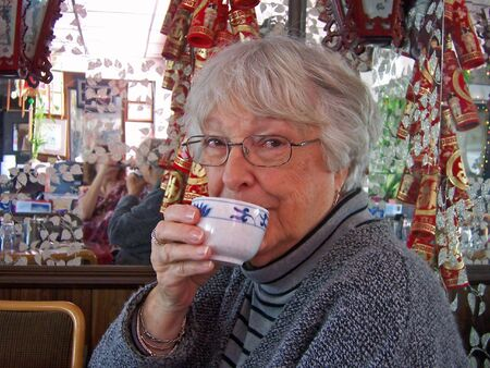 woman drinking cup of chinese hot tea photo