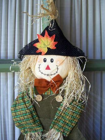 scarecrow hanging on a back porch door Banco de Imagens