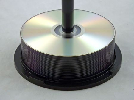 dvds: cds and dvds stacked on a spindle Stock Photo