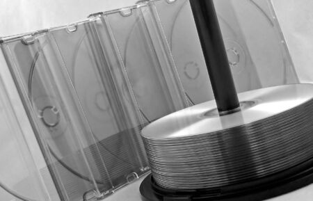 cds: cds on spindle with cd cases in black & white Stock Photo