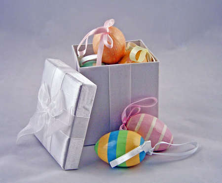 pastel colored easter eggs in white box Imagens