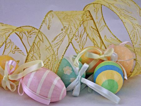 pastel colored easter eggs with gold ribbon