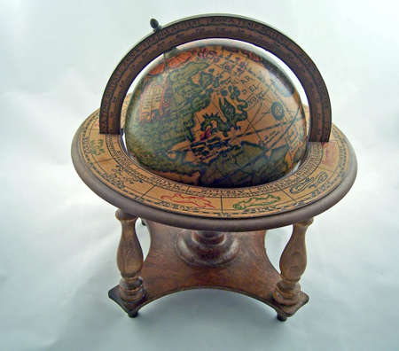 an old world globe in stand