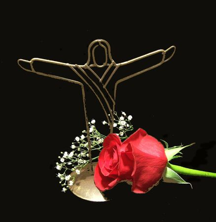 jesus rose: Jesus Christ decoration with red rose and babys breath Stock Photo
