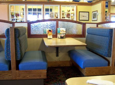 an empty booth in a casual restaurant
