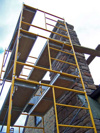 refurbishment: scaffolding used for residential house construction restoration Stock Photo