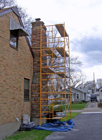 secure site: scaffolding used for residential house construction restoration Stock Photo