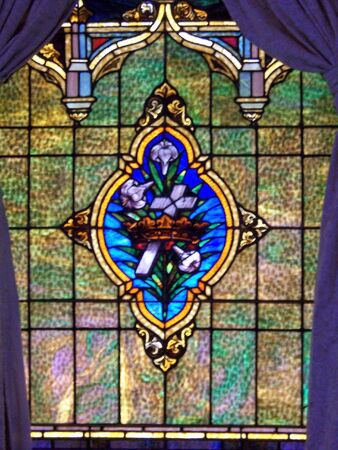 stain glass window with royal cross and crown