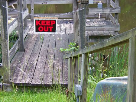 no fishing off this old wooden dock  photo