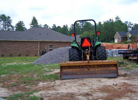 heavy construction equipment at site of brand new home photo
