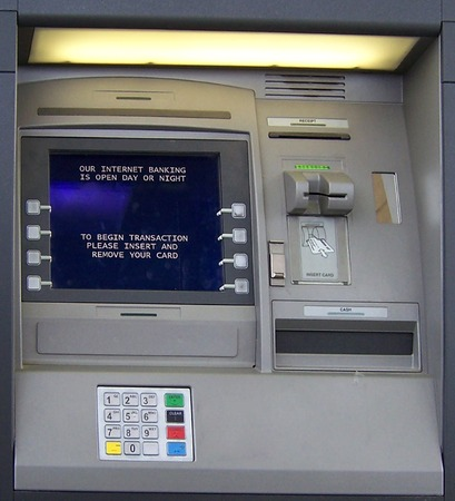 automatic teller machine bank: ATM automated teller machine at local bank Stock Photo