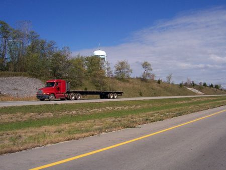 flatbed semi truck driving on divided highway