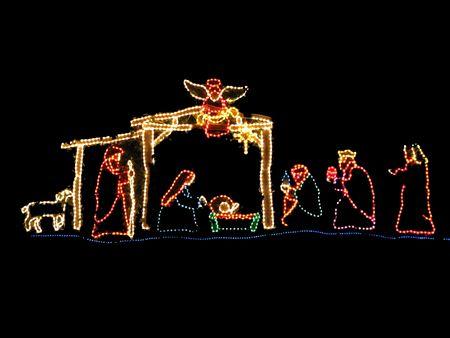 pesebre: pesebre en la bella escena de colores luces de Navidad Foto de archivo