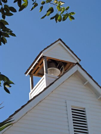 schoolhouse: historical schoolhouse with bell in rooftop cupola