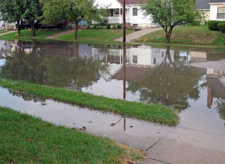 runoff: residential city street flooded after heavy rain