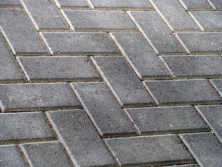 a gray colored landscape of brick pavers photo