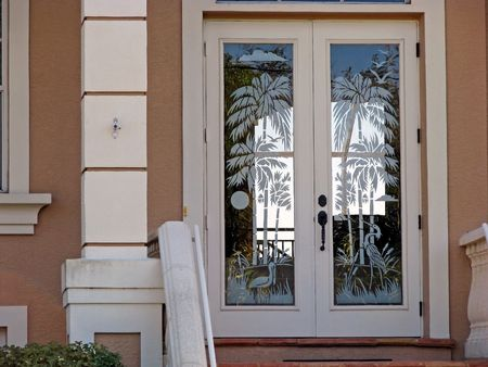 etch: a beautiful door etched in tropical scene