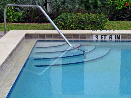peaceful empty swimming pool ladder and steps