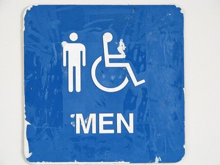 old restroom sign with men handicap characters photo