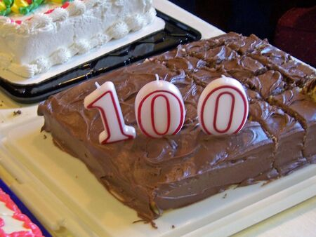 celebratory event: birthday cake with candles shaped in 100