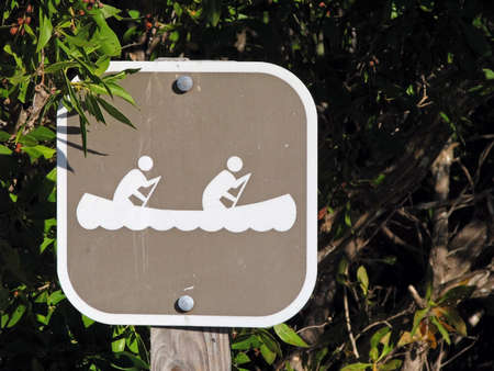 symbolization: a posted designated canoe launch sites sign Stock Photo