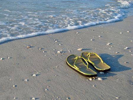 flip flops: pair of green flip flops sandals on beach